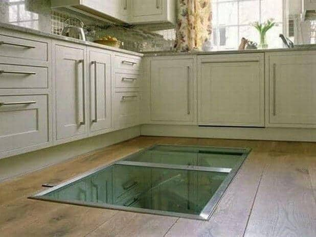 Wine lovers cut hole in their floor feature