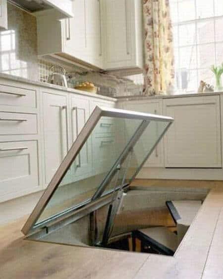 Wine lovers cut hole in their kitchen floor